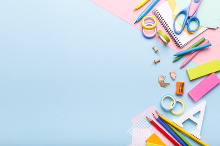 Foto de Colorful stationery school supplies on blue trending background, space or text flat lay - Imagen libre de derechos