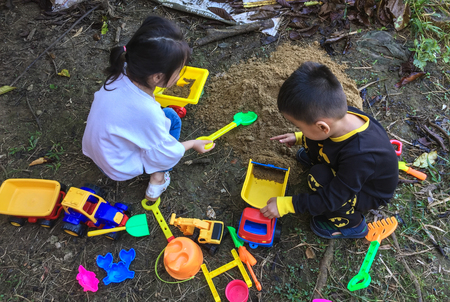 Photo for Saigon, Vietnam - Dec 5, 2017. Children playing at outdoor park in Saigon (Ho Chi Minh City), Vietnam. - Royalty Free Image