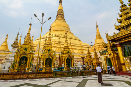 Photo for Yangon, Myanmar - Feb 26, 2016. People walking at Shwedagon Pagoda in Yangon, Myanmar. Shwedagon is known as the most sacred pagoda in Myanmar. - Royalty Free Image