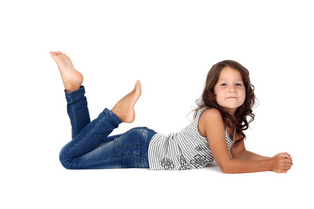 Foto de little child in jeans lying on the floor - Imagen libre de derechos