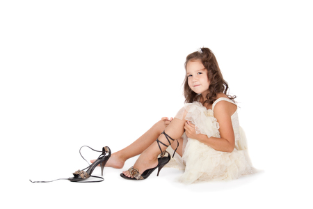 Photo for little girl trying on the big shoes - Royalty Free Image