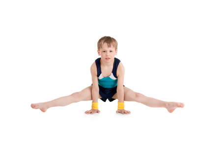Photo for little boy gymnast doing exercises - Royalty Free Image