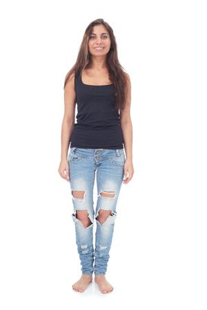 Foto de pretty teen girl wearing ripped jeans - Imagen libre de derechos