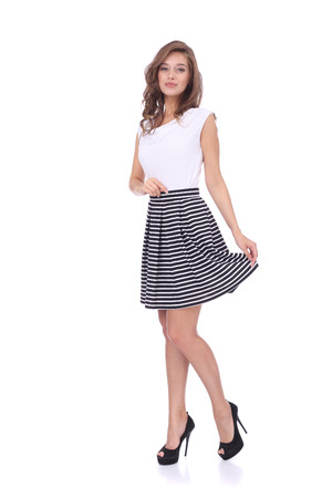 Photo for pretty young girl wearing short striped skirt - Royalty Free Image