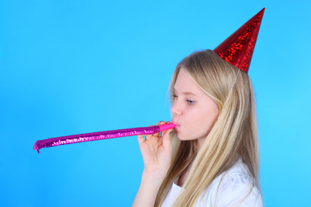 Foto de pretty teenage girl in the white dress and birthday cap - Imagen libre de derechos