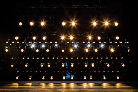 Foto de Spotlights & lighting equipment for the theater. Yellow light. - Imagen libre de derechos