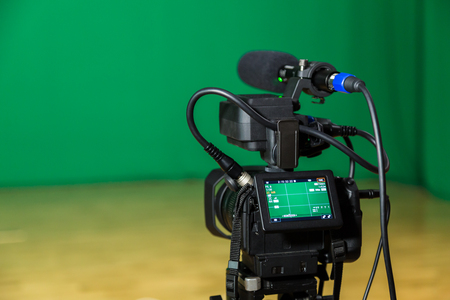 Photo for Digital camera in a Television Studio. Filming on green screen chroma key. - Royalty Free Image