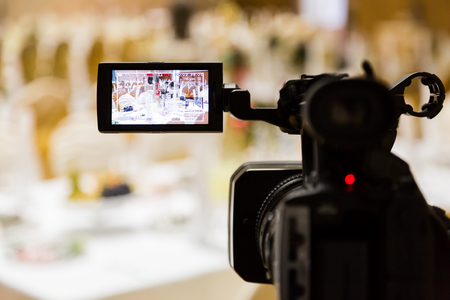 Photo pour Filming of the event. Videography. Served tables in the Banquet hall. - image libre de droit