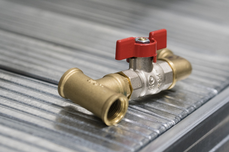Photo pour Small valve and screw fitting in the rack. - image libre de droit