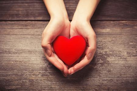 Photo pour Female hands giving red heart - image libre de droit