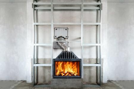 Foto de Fireplace installing. Metal frame for installing Fire Protection Board. - Imagen libre de derechos