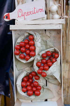 Still life of fresh tomatoes on background of straw mats. The village fair of agriculture