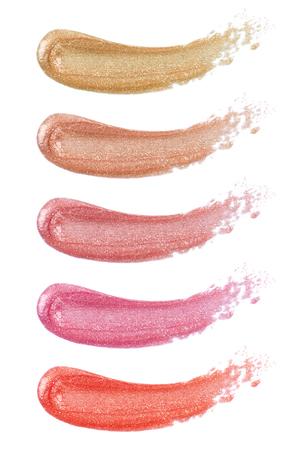 Photo pour Different lip glosses isolated on white - image libre de droit