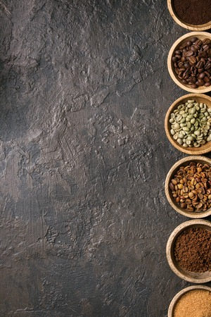 Photo for Variety of grounded, instant coffee, different coffee beans, brown sugar in wooden bowls in row over dark texture background. Top view, space - Royalty Free Image