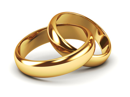 Foto per A pair of gold wedding rings - Immagine Royalty Free