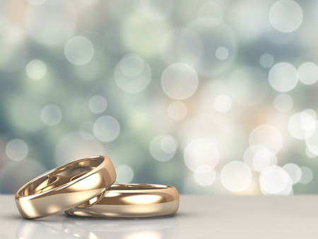 Foto de A pair of gold wedding rings with bokeh background - Imagen libre de derechos