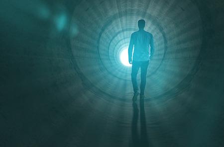 Foto de Man walking to the light at the end of the tunnel - Imagen libre de derechos