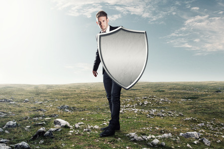 Foto per Man with an iron shield - Immagine Royalty Free