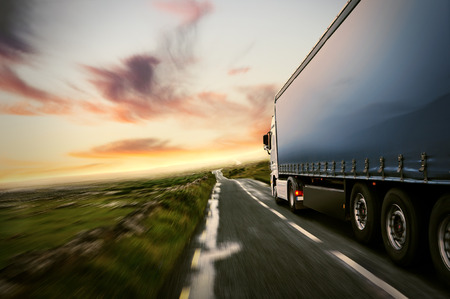 Foto per Truck on a country road at sunset - Immagine Royalty Free