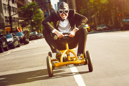 Photo for Businessman on a pedal car - Royalty Free Image
