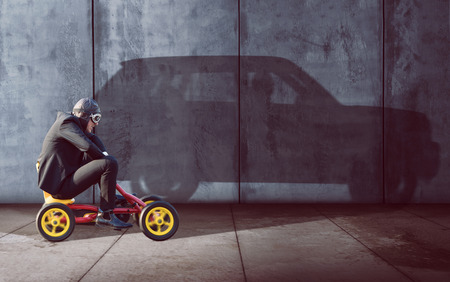 Photo pour Ambitous Businessman on a pedal car - image libre de droit