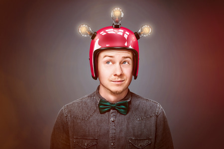 Foto de Genius man wearing red helm - Imagen libre de derechos