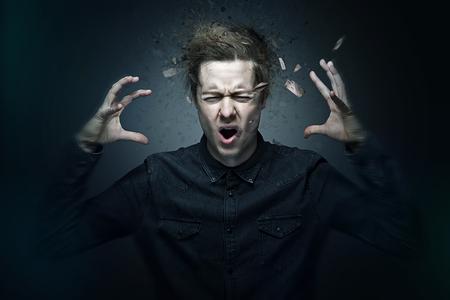 Foto de Aggression of young man - Imagen libre de derechos