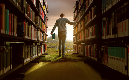 Photo pour Man in a fantasy library setting - image libre de droit