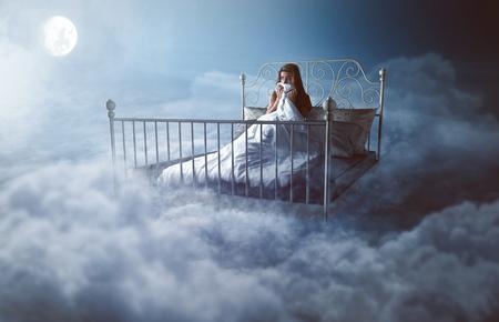 Foto de Woman wakes up in the clouds - Imagen libre de derechos