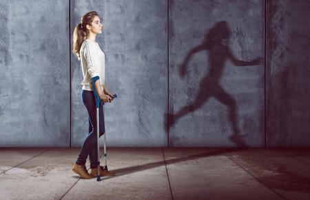Photo pour Handicapped woman with a running shadow - image libre de droit