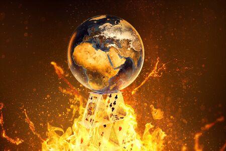 Foto de Earth lies on burning house of cards (3D Rendering) - Imagen libre de derechos