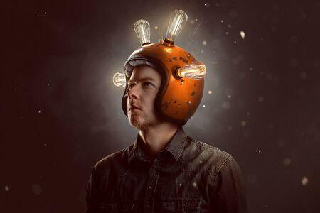 Foto de Young man with light bulb helmet - Imagen libre de derechos
