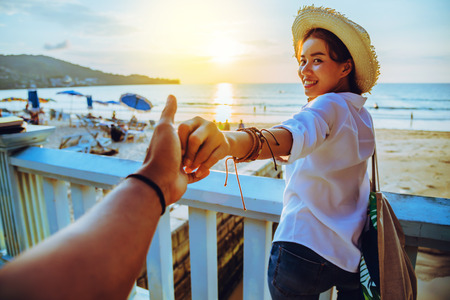 Foto de Asian lovers happy and be smile holding hands. Travel beach summer vacation. - Imagen libre de derechos