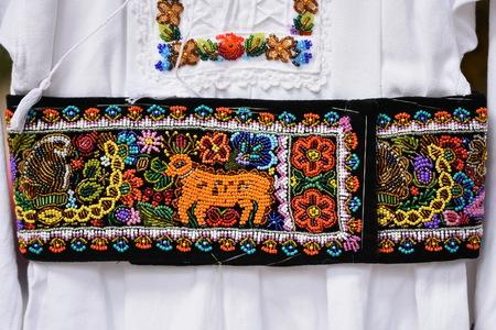 Foto de Detail of traditional Romanian folk costume from ARDEAL area, Romania. - Imagen libre de derechos
