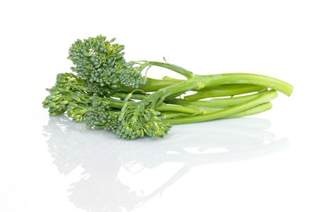 Fresh broccolini with reflection on white background