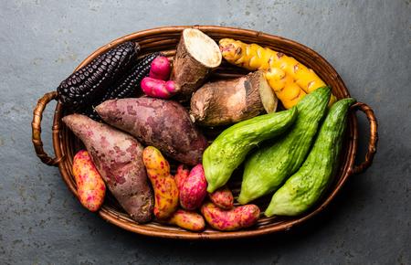 Photo pour Fresh peruvian Latin American vegetables caigua, sweet potatoes, black corn, camote, yuca. Top view - image libre de droit