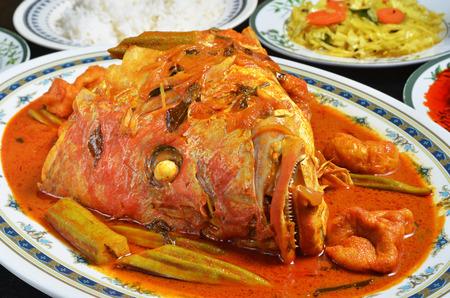 Foto de Curry fish head , Traditional malaysian cuisine - Imagen libre de derechos