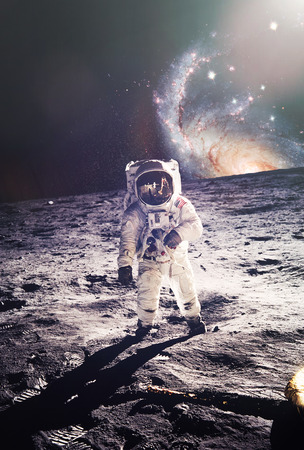 Astronaut walking on moon with galaxy background.  mural