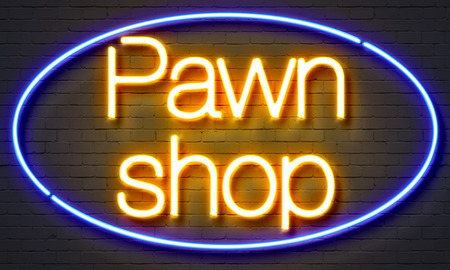 Pawn shop neon sign on brick wall background