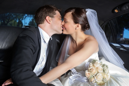 Photo for Newlywed couple kissing each other - Royalty Free Image