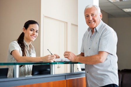 Photo for Senior Man Standing At Hospital Reception - Royalty Free Image