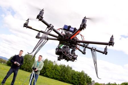 Foto de Photographer and Pilot with UAV - Imagen libre de derechos