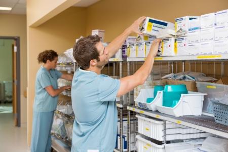 Foto de Nurses arranging stock in hospital storage room - Imagen libre de derechos