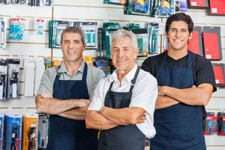 Foto für Confident Salesmen In Hardware Store - Lizenzfreies Bild