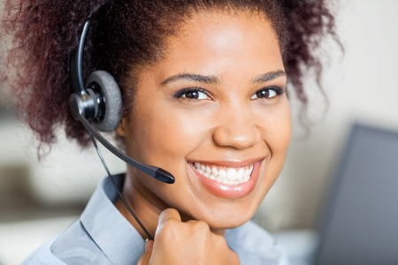 Photo pour Happy Female Customer Service Representative Wearing Headset - image libre de droit