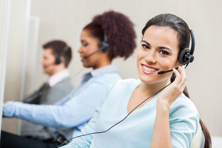 Photo pour Smiling Female Customer Service Agent In Office - image libre de droit