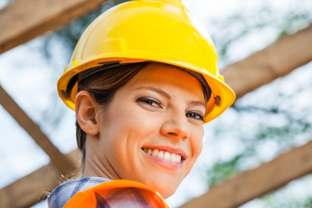 Photo pour Smiling Female Construction Worker At Site - image libre de droit