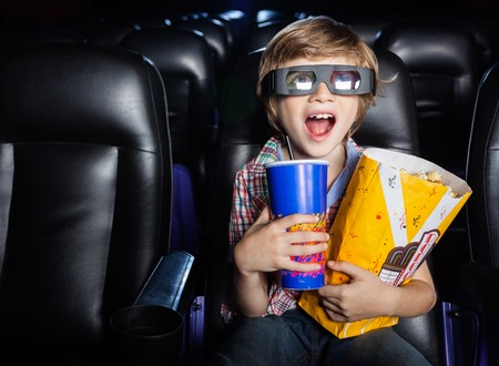 Photo for Surprised Boy Watching 3D Movie In Theater - Royalty Free Image