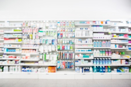 Photo for Defocused image of medicines arranged in shelves at pharmacy - Royalty Free Image