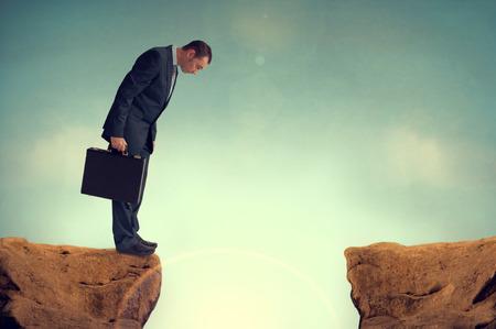 Photo pour businessman nervously facing an obstacle challenge - image libre de droit